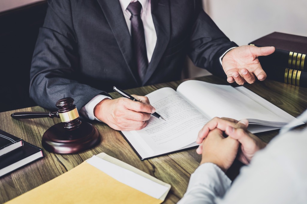 man talking to a lawyer